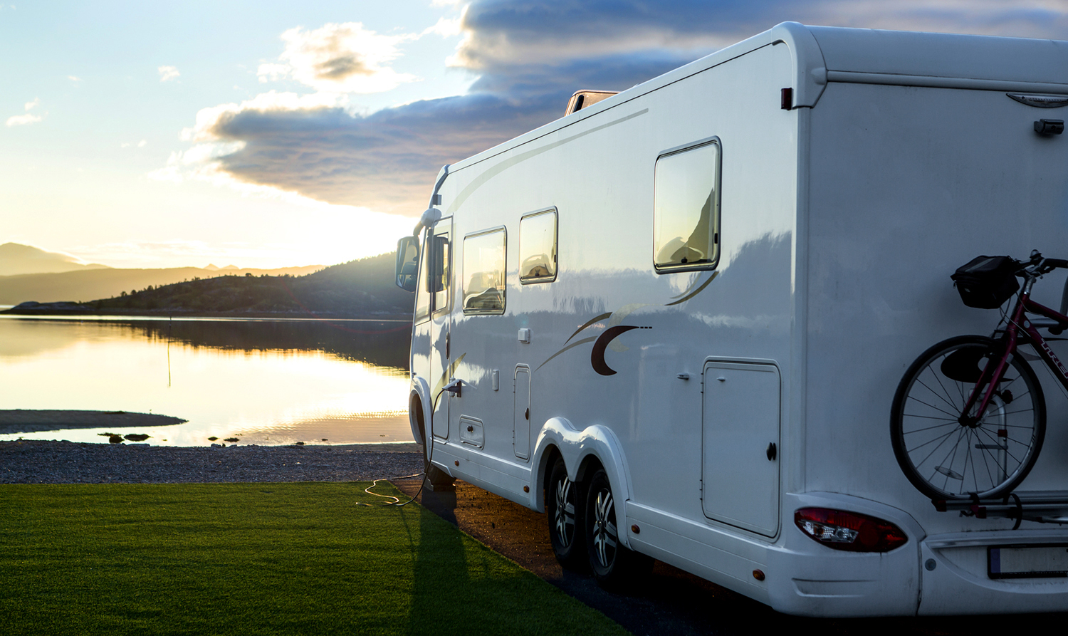 Large camper van motorhome parked near a lake after a thorough RV Inspection in Tennessee